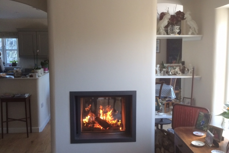 Stuv 21/75 doublesided woodburner installation