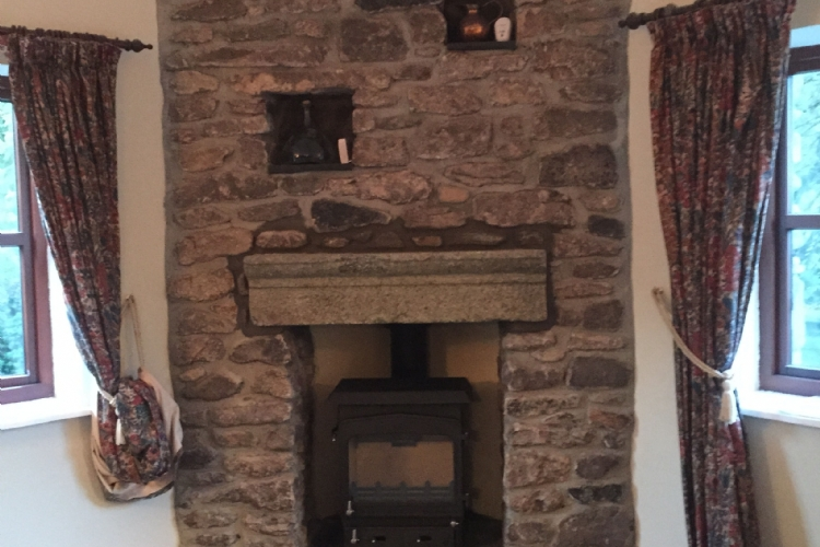 Adjusting a stone fireplace to fit a stove