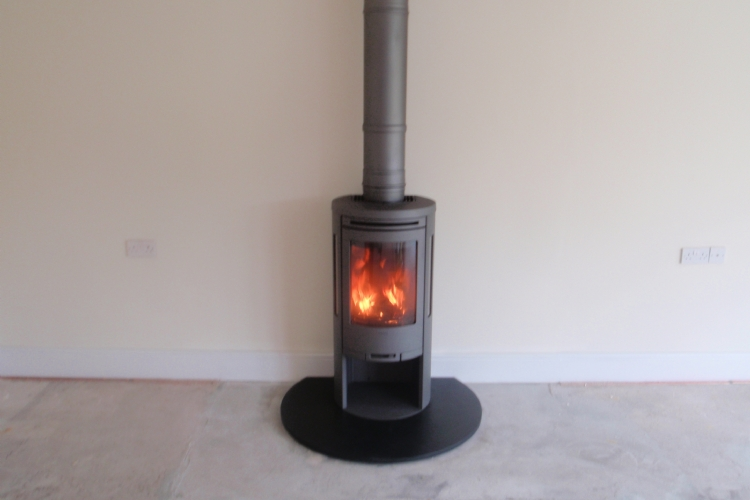 Contura 556 on a circular honed slate hearth