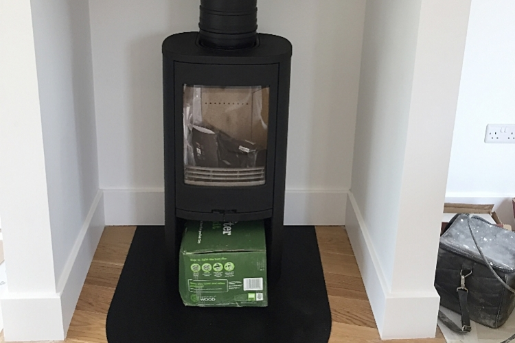 Contura woodburner in a fireplace