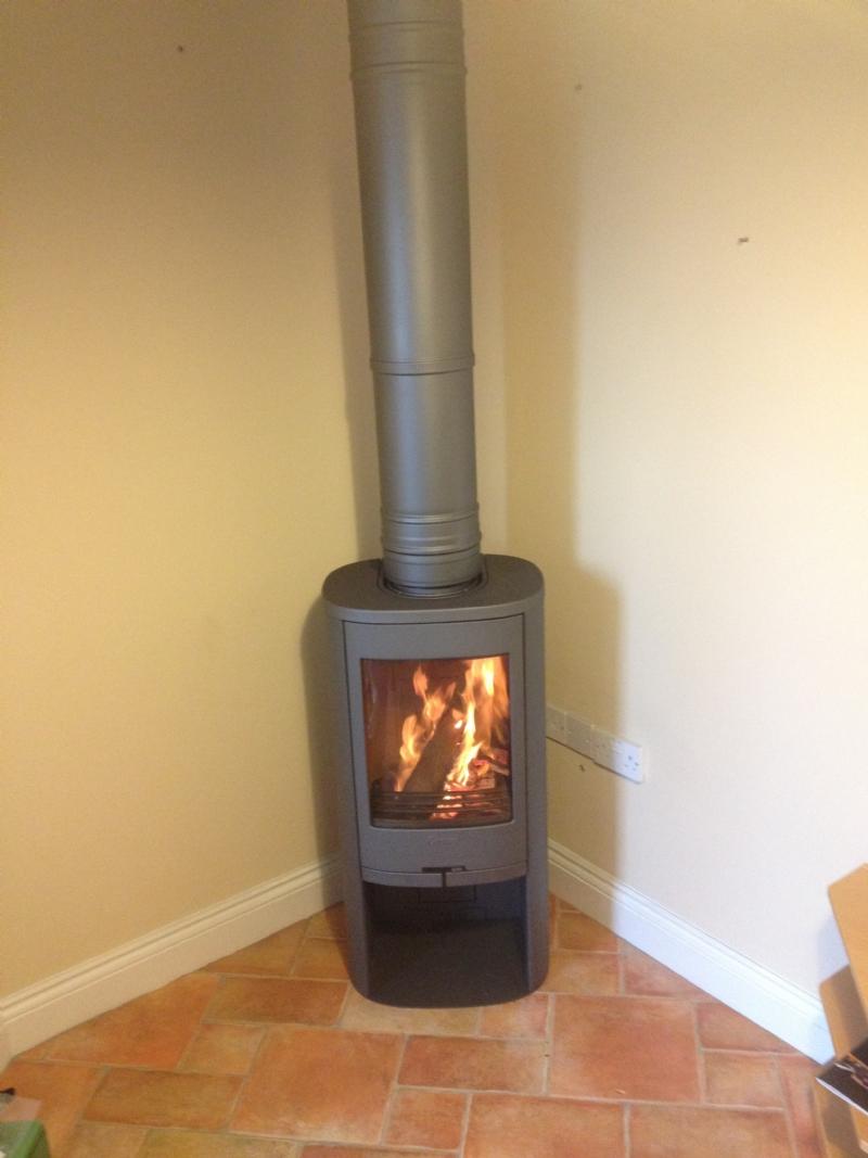 contura 810 in a corner wood burning stove installation. Black Bedroom Furniture Sets. Home Design Ideas