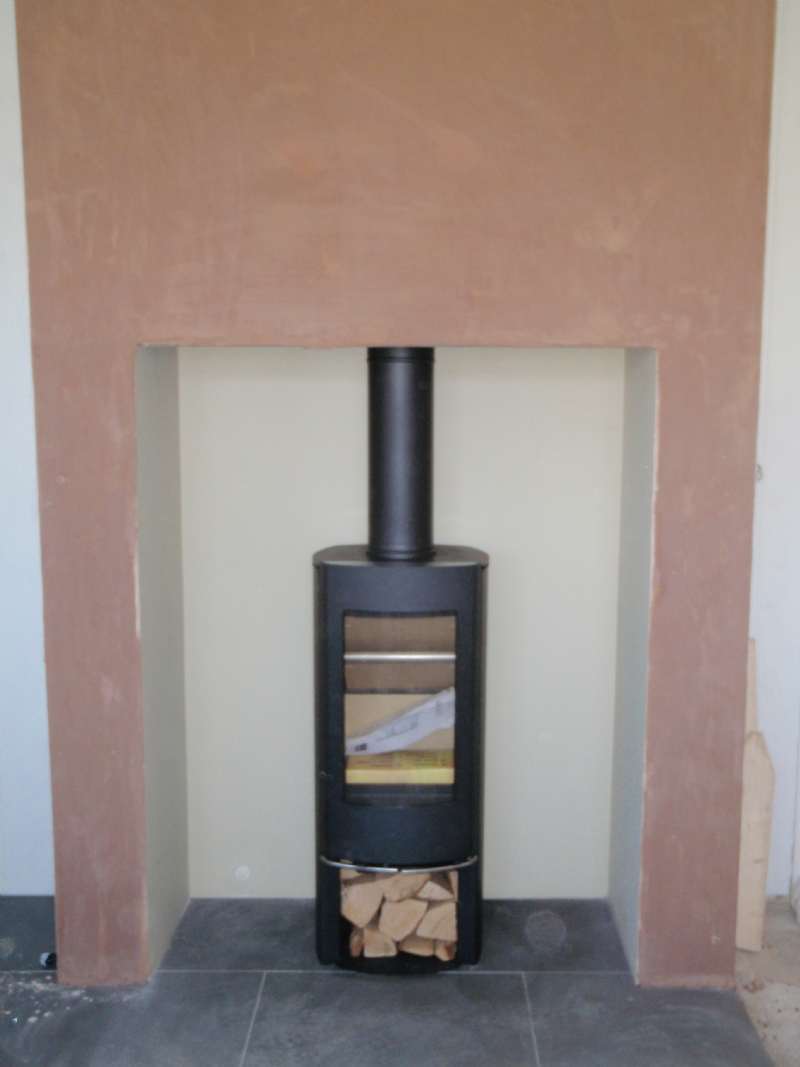 scan 45 mini in a large fireplace wood burning stove installation