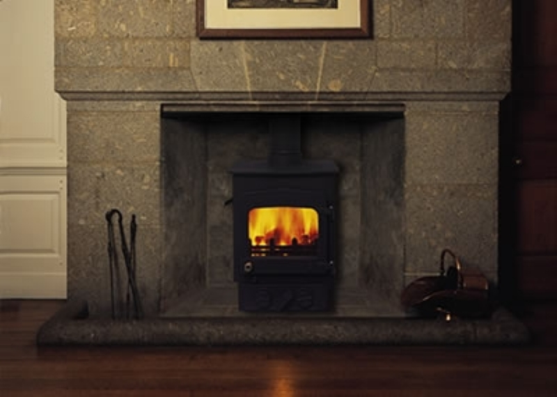 Woodwarm Fireview in a stone mantel