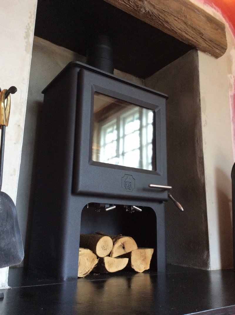 Replacing a fake Victorian fireplace with a wood burning stove ...