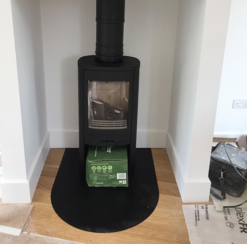 Contura woodburner in a fireplace
