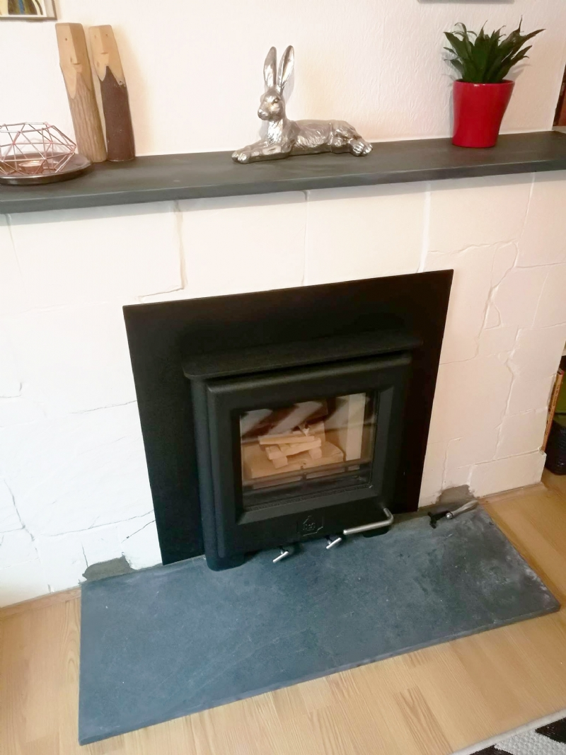 Woodwarm inset fire in brick