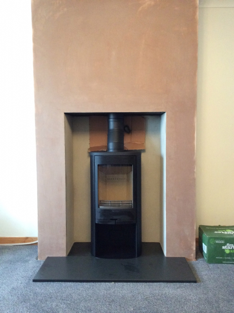 Contura 810 in freshly plastered fireplace