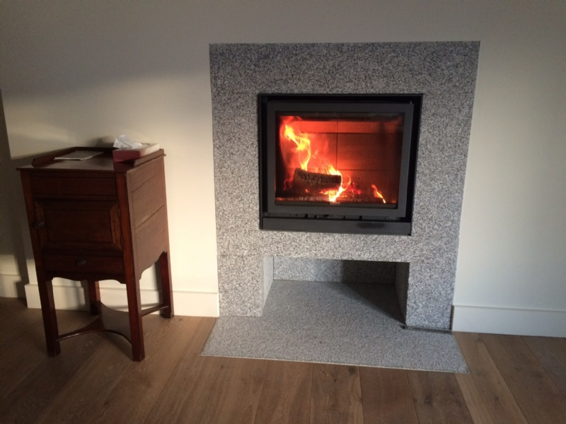 stuv 16  58 in bespoke granite surround wood burning stove Modern Fireplace Tile Surrounds Granite Fireplace Surround Ideas