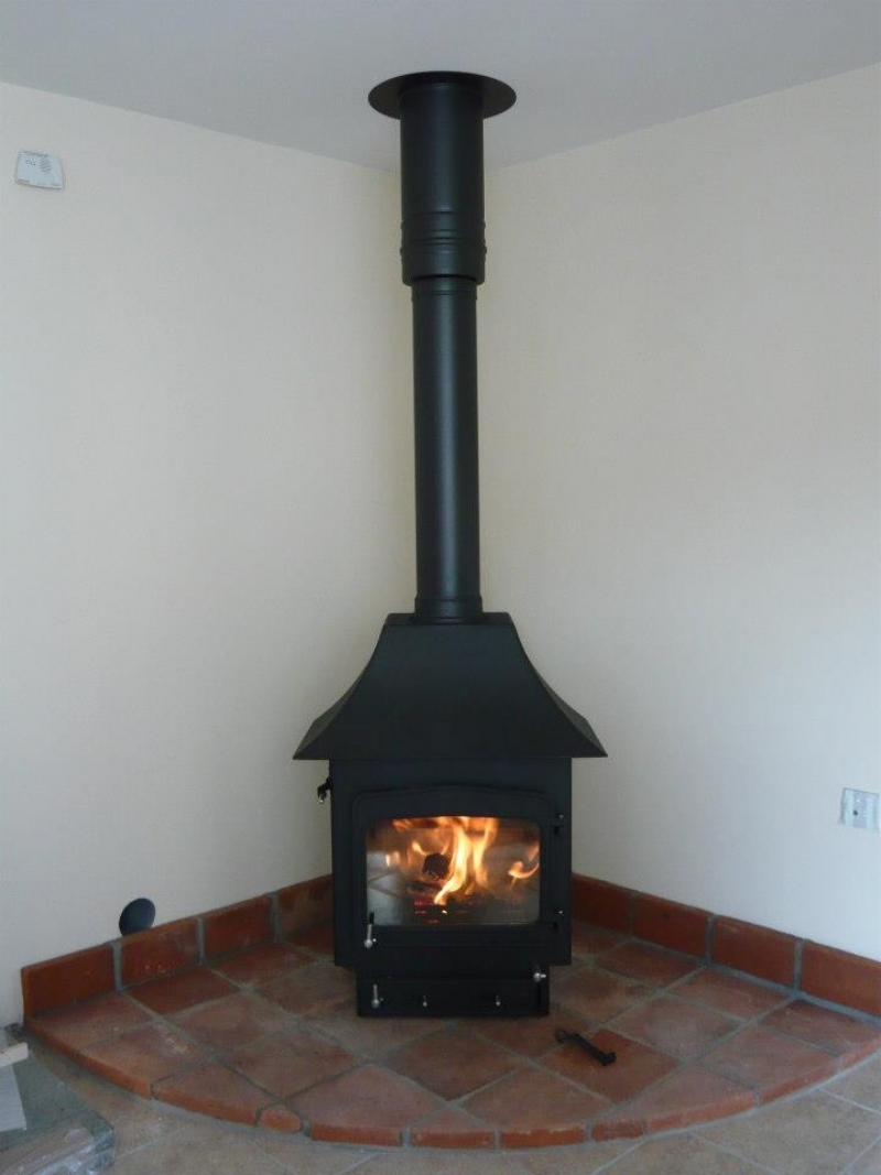 Woodwarm fireview with canopy on a tiled hearth