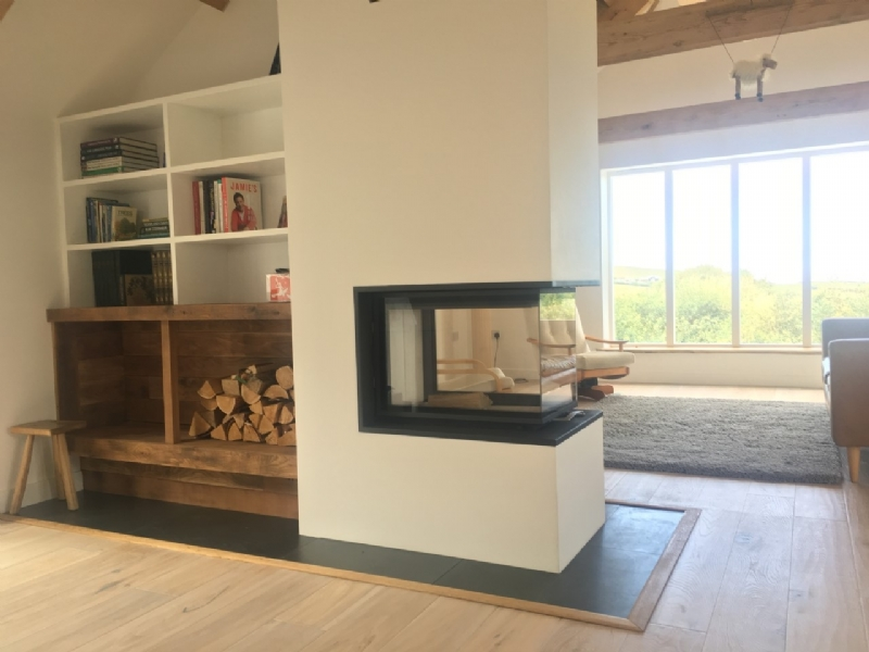Three sided fireplace and feature wall